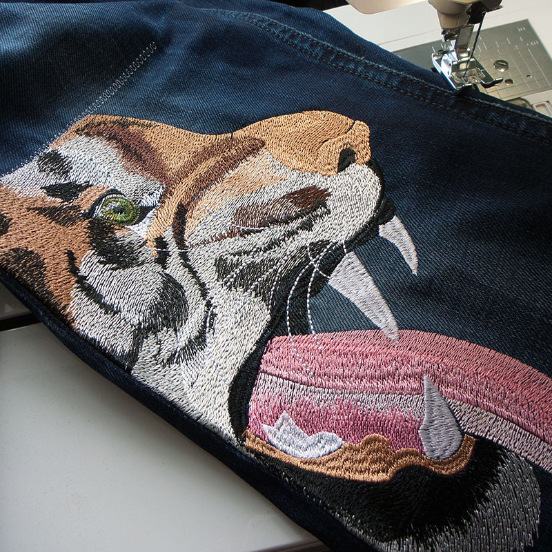 Машинная вышивка: Вышивка на джинсах